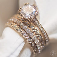 close-up of stackable gold and diamond wedding rings