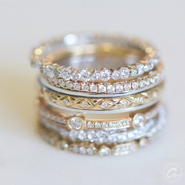 detail of diamond and gold wedding rings and anniversary bands by a. jaffe shown as eternity, bezeled, and channel set styles