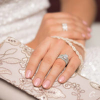 bride on her wedding day wearing her diamond engagement and wedding ring set