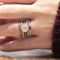 ruby and diamond stackable rings on her hand