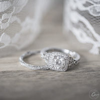 square cut diamond and white veile gold wedding set displayed a lovely lace v
