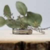 traditional style tips solid white gold wedding band with brushed metal shown with prong set diamond eternity wedding ring
